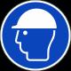 Een rond blauwe ISO 7010 sticker, met daarop een witte afbeelding van een hoofd met een veiligheidshelm.